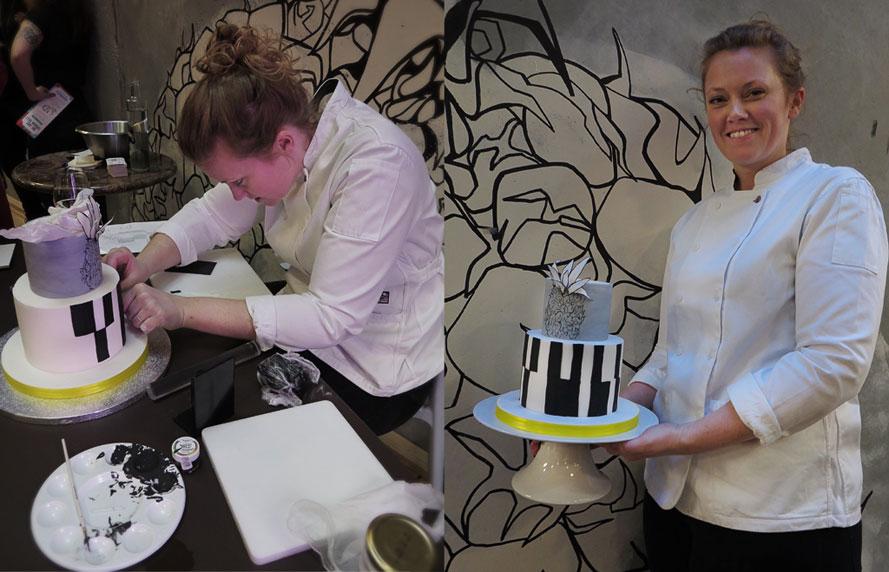 Thora L. Norgård har tårtan i sina händer